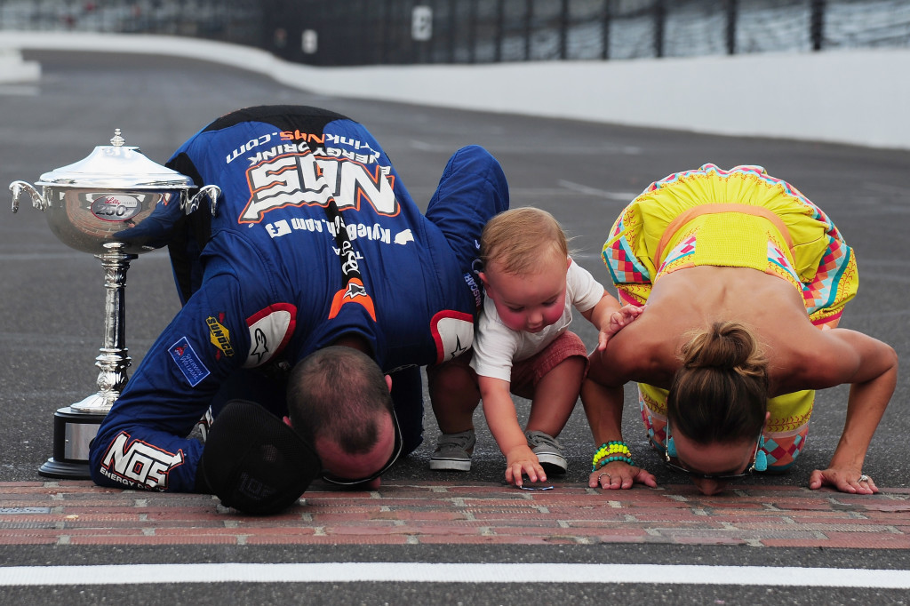 INDIANAPOLIS, IN - JULY 23:  Kyle Busch, driver of the #18 NOS Energy Drink Toyota, celebrates with his wife, Samantha, and son, Brexton, after winning the NASCAR XFINITY Series Lilly Diabetes 250 at Indianapolis Motor Speedway on July 23, 2016 in Indianapolis, Indiana.  (Photo by Jeff Curry/NASCAR via Getty Images)