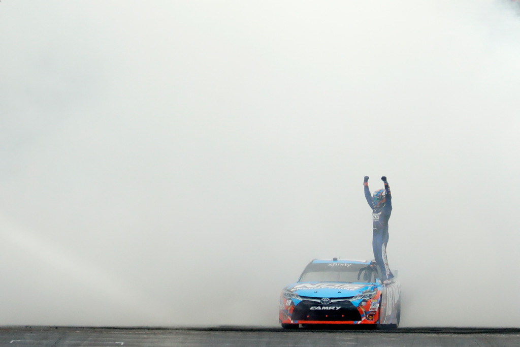 INDIANAPOLIS, IN - JULY 23:  Kyle Busch, driver of the #18 NOS Energy Drink Toyota, celebrates after winning the NASCAR XFINITY Series Lilly Diabetes 250 at Indianapolis Motor Speedway on July 23, 2016 in Indianapolis, Indiana.  (Photo by Andy Lyons/Getty Images)