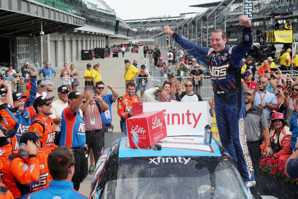 INDIANAPOLIS, IN - JULY 23:  Kyle Busch, driver of the #18 NOS Energy Drink Toyota, celebrates in victory lane after winning the NASCAR XFINITY Series Lilly Diabetes 250 at Indianapolis Motor Speedway on July 23, 2016 in Indianapolis, Indiana.  (Photo by Rey Del Rio/Getty Images)