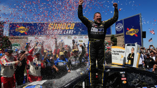 SONOMA, CA - JUNE 26:  Tony Stewart, driver of the #14 Code 3 Assoc/Mobil 1 Chevrolet, celebrates in victory lane after winning the NASCAR Sprint Cup Series Toyota/Save Mart 350 at Sonoma Raceway on June 26, 2016 in Sonoma, California.  (Photo by Chris Trotman/NASCAR via Getty Images)
