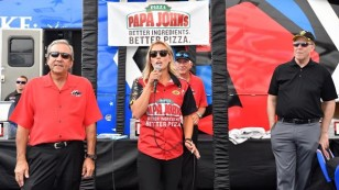 16PapaJohnsDonSchumacher Pritchett Peter Clifford NHRA President Photo Aug 5_Feature