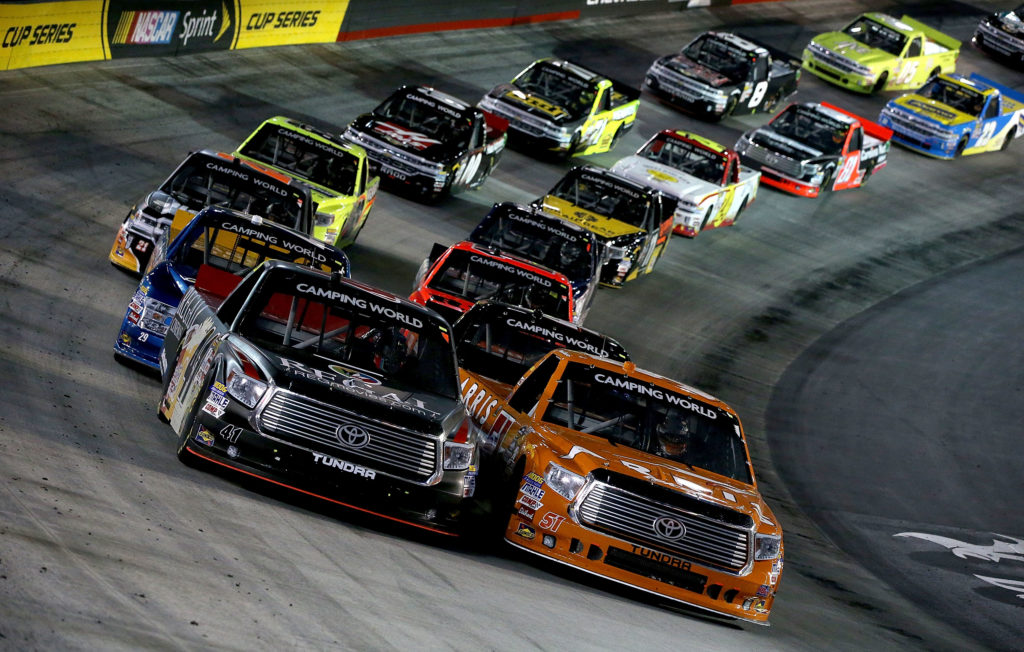 Daniel Suarez, driver of the #51 ARRIS Toyota, leads the field druing ar restart of the NASCAR Camping World Truck Series UNOH 200 at Bristol Motor Speedway on August 17, 2016 in Bristol, Tennessee.  (Photo by Sean Gardner/NASCAR via Getty Images)