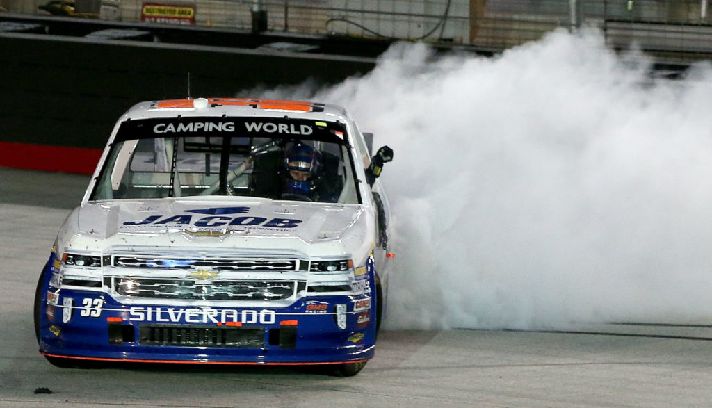 Ben Kennedy, driver of the #33 Jacob Chevrolet, does a burnout  after winning the NASCAR Camping World Truck Series UNOH 200 at Bristol Motor Speedway (Photo by Sean Gardner/NASCAR via Getty Images)