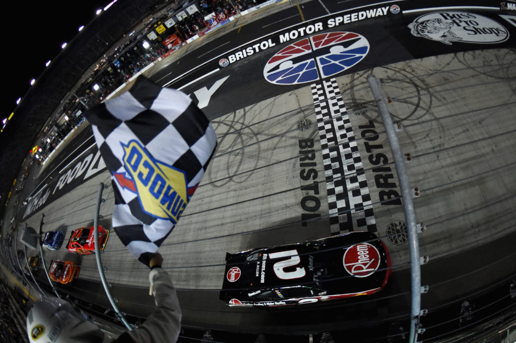 BRISTOL, TN - AUGUST 19: Austin Dillon, driver of the #2 Rheem Chevrolet, takes the checkered flag during the NASCAR XFINITY Series Food City 300 at Bristol Motor Speedway on August 19, 2016 in Bristol, Tennessee.  (Photo by Rainier Ehrhardt/NASCAR via Getty Images)