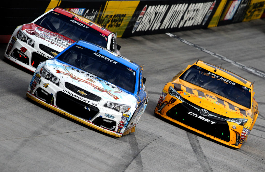 BRISTOL, TN - AUGUST 21: Kevin Harvick, driver of the #4 Busch Beer Chevrolet, leads a pack of cars during the NASCAR Sprint Cup Series Bass Pro Shops NRA Night Race at Bristol Motor Speedway on August 21, 2016 in Bristol, Tennessee. The race was delayed due to inclement weather on Saturday, August 20. (Photo by Brian Lawdermilk/Getty Images)
