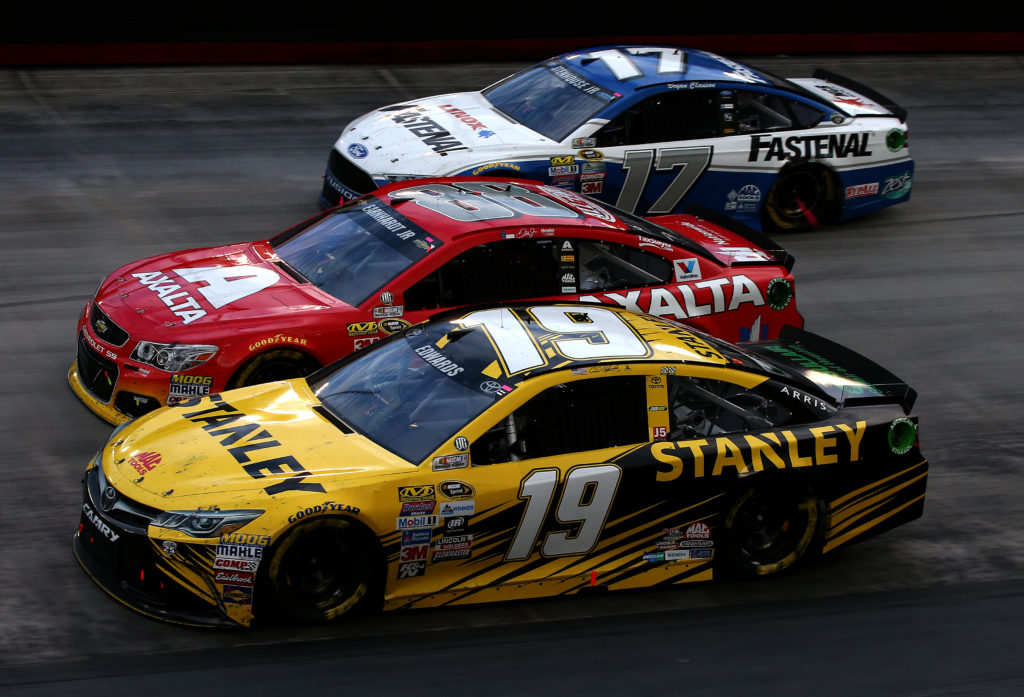 BRISTOL, TN - AUGUST 21: Carl Edwards, driver of the #19 Stanley Toyota, Jeff Gordon, driver of the #88 Axalta Chevrolet, and Ricky Stenhouse Jr., driver of the #17 Fastenal Ford, race during the NASCAR Sprint Cup Series Bass Pro Shops NRA Night Race at Bristol Motor Speedway on August 21, 2016 in Bristol, Tennessee. The race was delayed due to inclement weather on Saturday, August 20. (Photo by Sean Gardner/Getty Images)
