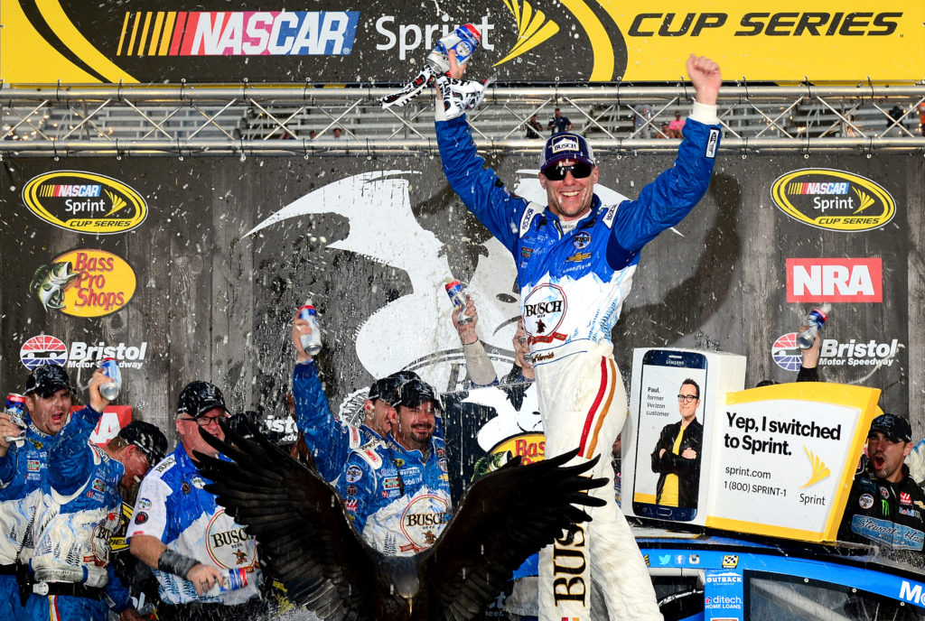 BRISTOL, TN - AUGUST 21: Kevin Harvick, driver of the #4 Busch Beer Chevrolet, celebrates in victory lane after winning the NASCAR Sprint Cup Series Bass Pro Shops NRA Night Race at Bristol Motor Speedway on August 21, 2016 in Bristol, Tennessee. The race was delayed due to inclement weather on Saturday, August 20. (Photo by Jeff Curry/NASCAR via Getty Images)