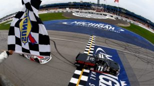 BROOKLYN, MI - AUGUST 27:  Brett Moffitt, driver of the #11 Red Horse Racing Toyota, takes the checkered flag to win the NASCAR Camping World Truck Series Careers for Veterans 200 at Michigan International Speedway on August 27, 2016 in Brooklyn, Michigan.  (Photo by Jeff Zelevansky/NASCAR via Getty Images)