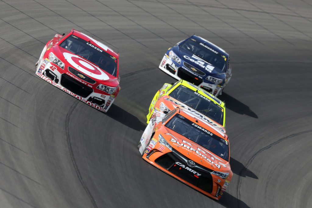 BROOKLYN, MI - AUGUST 28:  Carl Edwards, driver of the #19 ARRIS SurfBoard Toyota, races Kyle Larson, driver of the #42 Target Chevrolet, during the NASCAR Sprint Cup Series Pure Michigan 400 at Michigan International Speedway on August 28, 2016 in Brooklyn, Michigan.  (Photo by Jerry Markland/Getty Images)