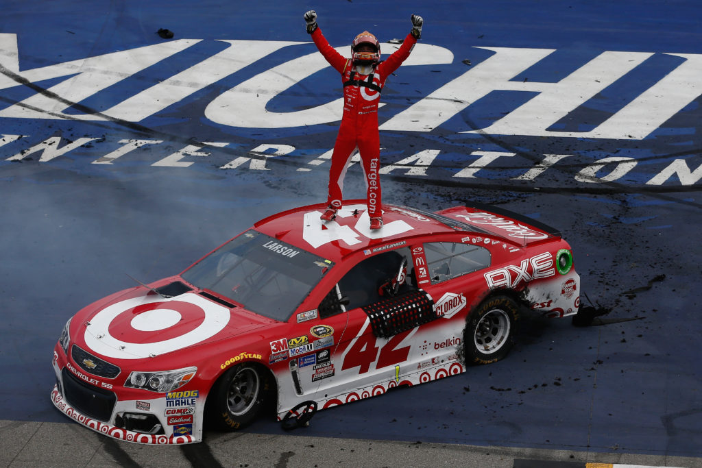 BROOKLYN, MI - AUGUST 28:  Kyle Larson, driver of the #42 Target Chevrolet, celebrates after winning the NASCAR Sprint Cup Series Pure Michigan 400 at Michigan International Speedway on August 28, 2016 in Brooklyn, Michigan.  (Photo by Jeff Zelevansky/NASCAR via Getty Images)