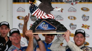 LONG POND, PA - AUGUST 01:  (R-L) Chris Buescher, driver of the #34 Dockside Logistics Ford, and crew chief Bob Osborne pose with the trophy after winning the NASCAR Sprint Cup Series Pennsylvania 400 at Pocono Raceway on August 1, 2016 in Long Pond, Pennsylvania. The race was delayed due to inclement weather on Sunday, July 31.  (Photo by Brian Lawdermilk/Getty Images)