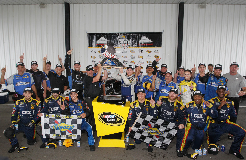 Chris Buescher, driver of the #34 Dockside Logistics Ford, celebrates in victory lane after winning the NASCAR Sprint Cup Series Pennsylvania 400 at Pocono Raceway on August 1, 2016 in Long Pond, Pennsylvania. The race was delayed due to inclement weather on Sunday, July 31.  (Photo by Brian Lawdermilk/Getty Images)