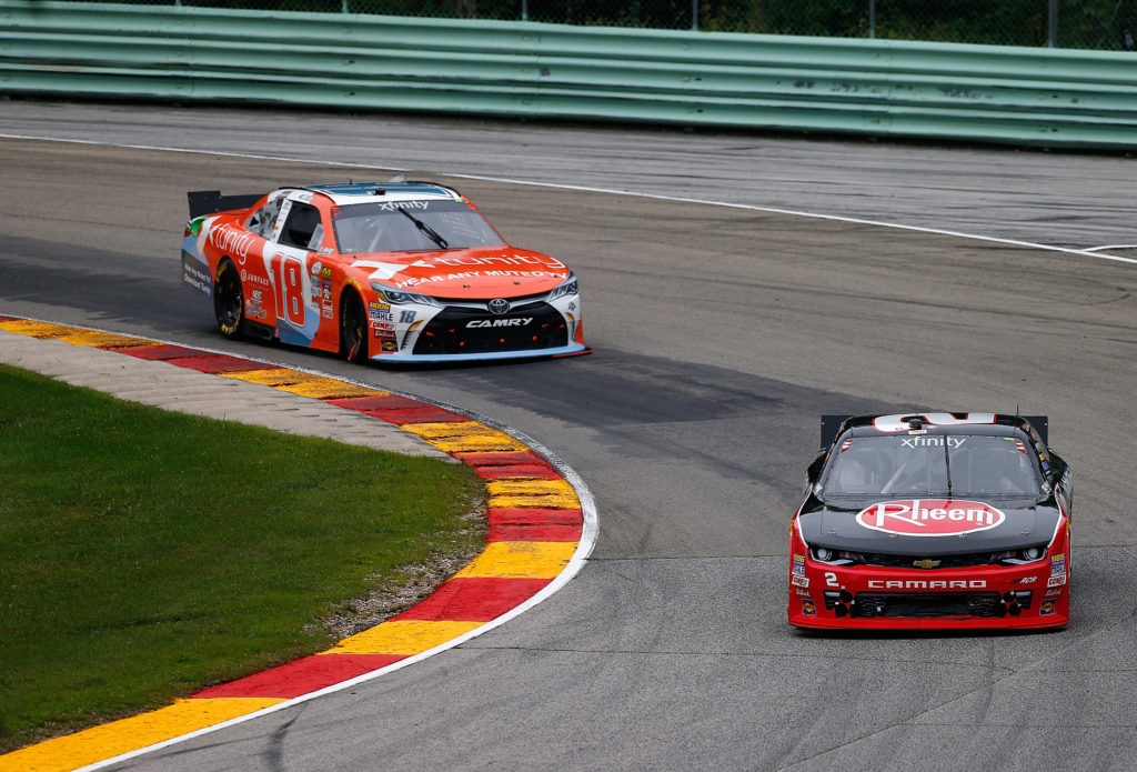 ELKHART LAKE, WI - AUGUST 27:  Michael McDowell drives the #2 Rheem  Chevrolet ahead of Owen Kelly drives the #18 Tunity Toyota during the NASCAR Xfinity Series Road America 180 fired up by Johnsonville at Road America on August 27, 2016 in Elkhart Lake, Wisconsin.  (Photo by Jonathan Ferrey/NASCAR via Getty Images)