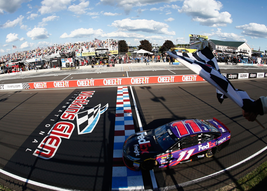 Denny Hamlin, driver of the #11 FedEx Freight Toyota, takes the checkered flag to win.(Photo by Jeff Zelevansky/NASCAR via Getty Images)