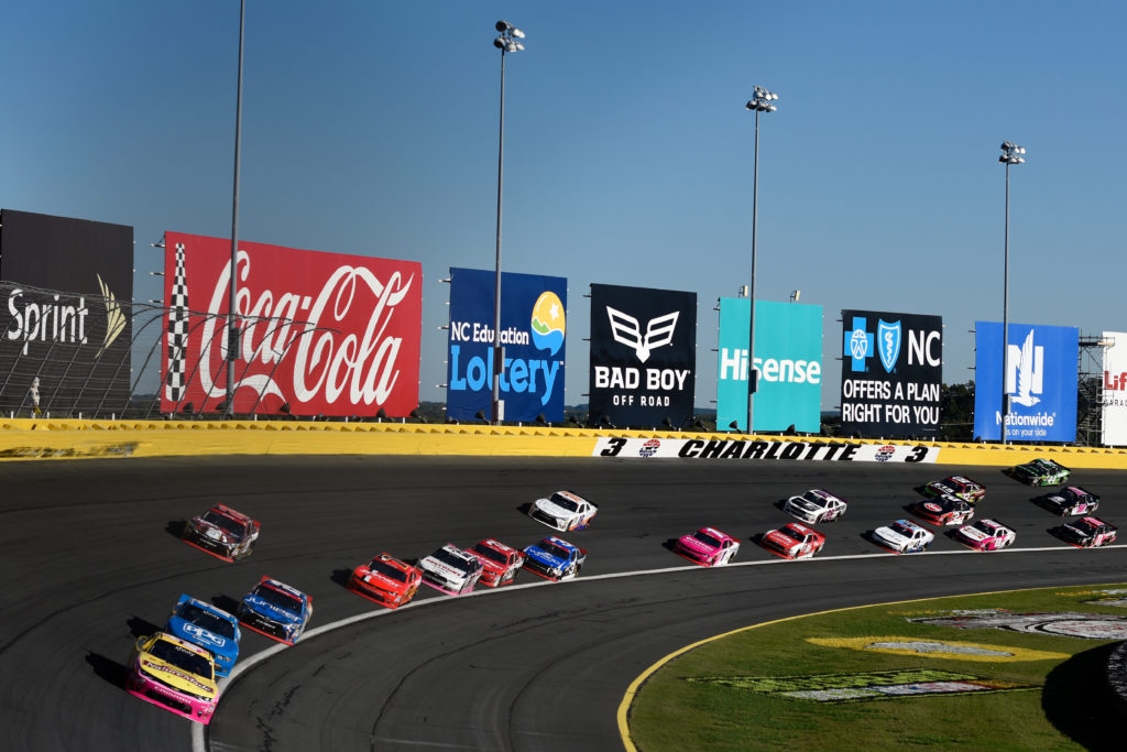 Kyle Larson leads a pack of cars.  (Photo by Jared C. Tilton/NASCAR via Getty Images)