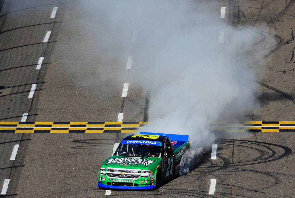 Johnny Sauter celebrates with a burnout.  (Photo by Daniel Shirey/Getty Images)