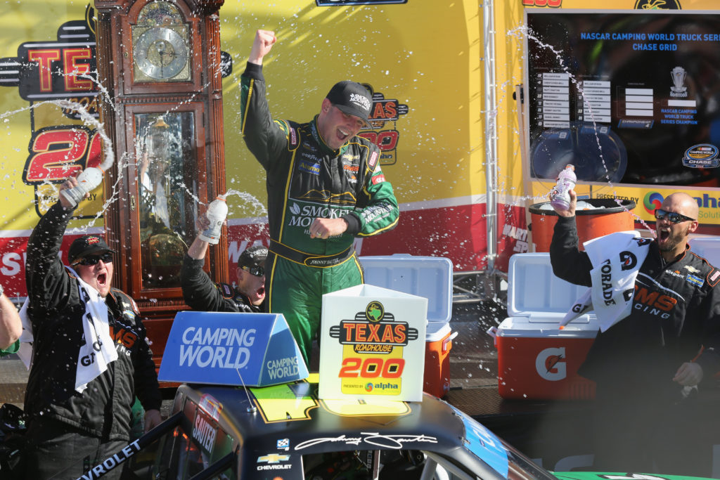 Johnny Sauter celebrates in Victory Lane.  (Photo by Jerry Markland/Getty Images)