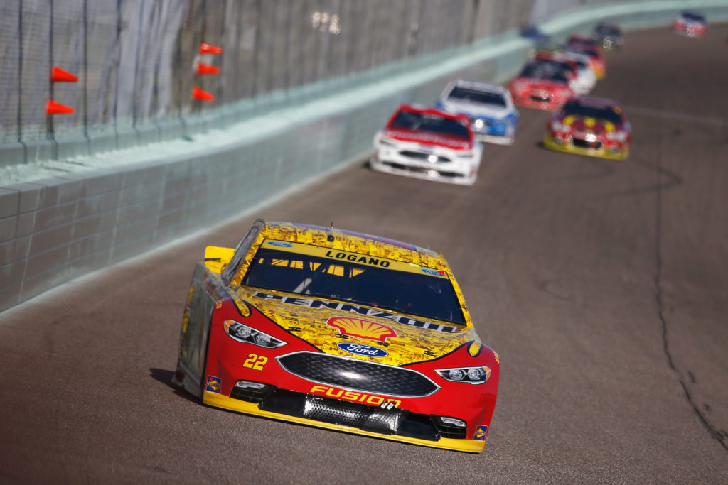 Joey Logano leads a pack of cars.  (Photo by Chris Trotman/Getty Images)
