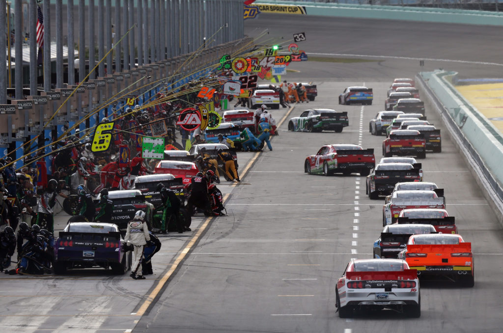 Cars pit during the NASCAR XFINITY Series Ford EcoBoost 300.  (Photo by Jerry Markland/Getty Images)