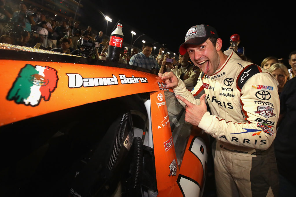 Daniel Suarez poses with the championship decal.  (Photo by Sarah Crabill/Getty Images)