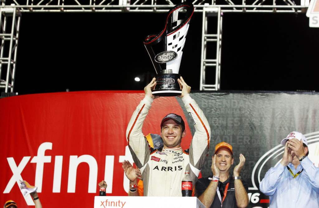 Daniel Suarez celebrates with the trophy.  (Photo by Sarah Crabill/Getty Images)