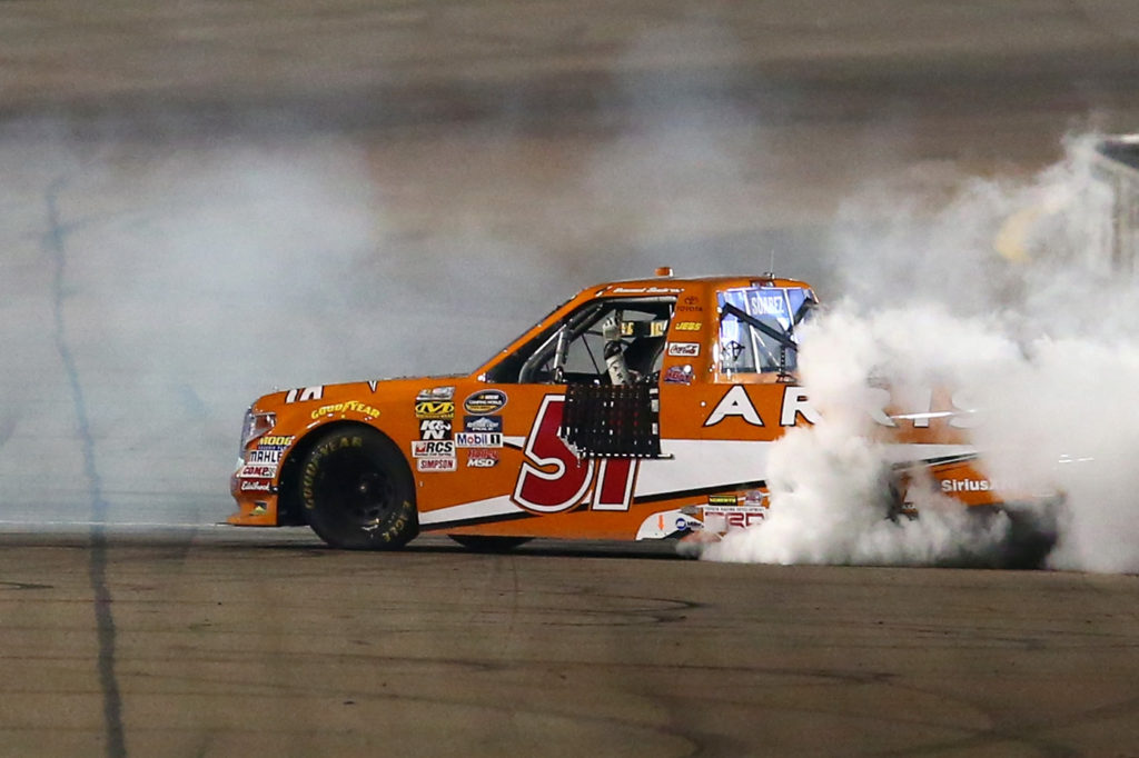Daniel Suarez celebrates with a burnout.  (Photo by Sarah Crabill/Getty Images)