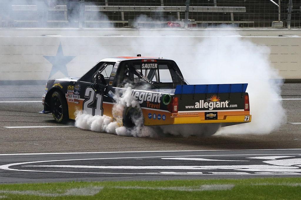 Johnny Sauter celebrates with a burnout.  (Photo by Matt Sullivan/NASCAR via Getty Images)