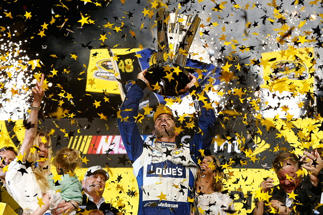 Johnson and crew celebrate after the victory at Homestead-Miami.