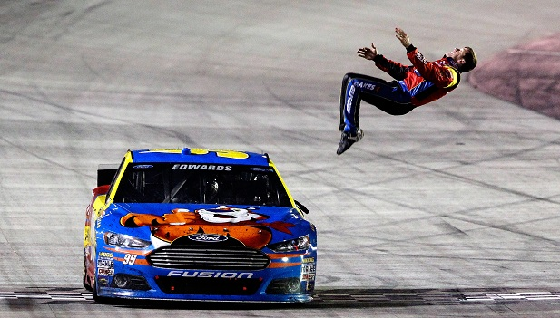 BRISTOL, TN - MARCH 16: Carl Edwards, driver of the #99 Kellogg's/Frosted Flakes Ford, celebrates with a backflip after winning the NASCAR Sprint Cup Series Food City 500 at Bristol Motor Speedway on March 16, 2014 in Bristol, Tennessee. (Photo by Brian Lawdermilk/NASCAR via Getty Images)