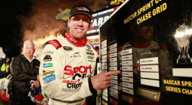 Carl Edwards, driver of the #19 Sport Clips Toyota, points to the Championship Round of the Chase Grid in Victory Lane after winning the rain-shortened NASCAR Sprint Cup Series AAA Texas 500 at Texas Motor Speedway on November 6, 2016 in Fort Worth, Texas.  (Photo by Matt Sullivan/NASCAR via Getty Images)