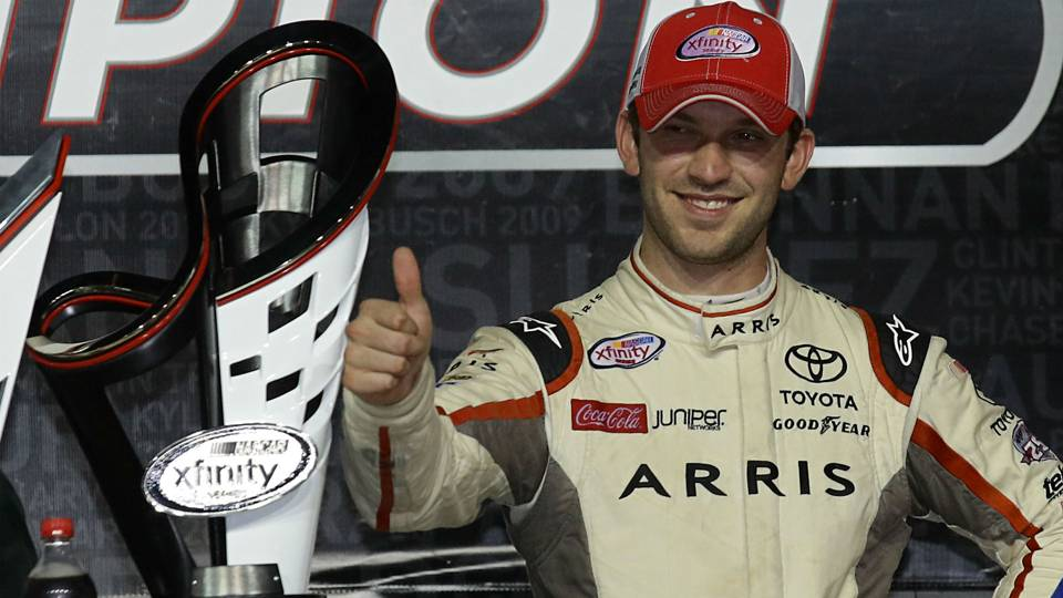Photo: Courtesy of NASCAR. Daniel Suarez gives a championship a thumbs up.