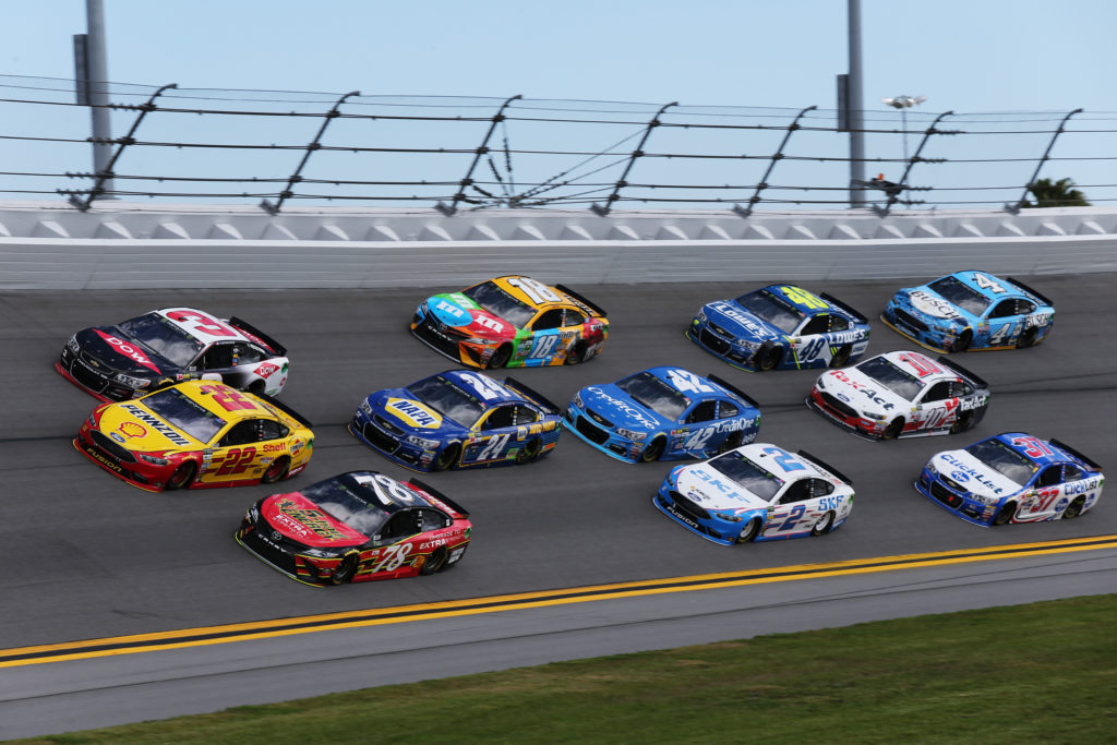 Martin Truex Jr. and Austin Dillon lead a pack of cars.  (Photo by Jerry Markland/Getty Images)
