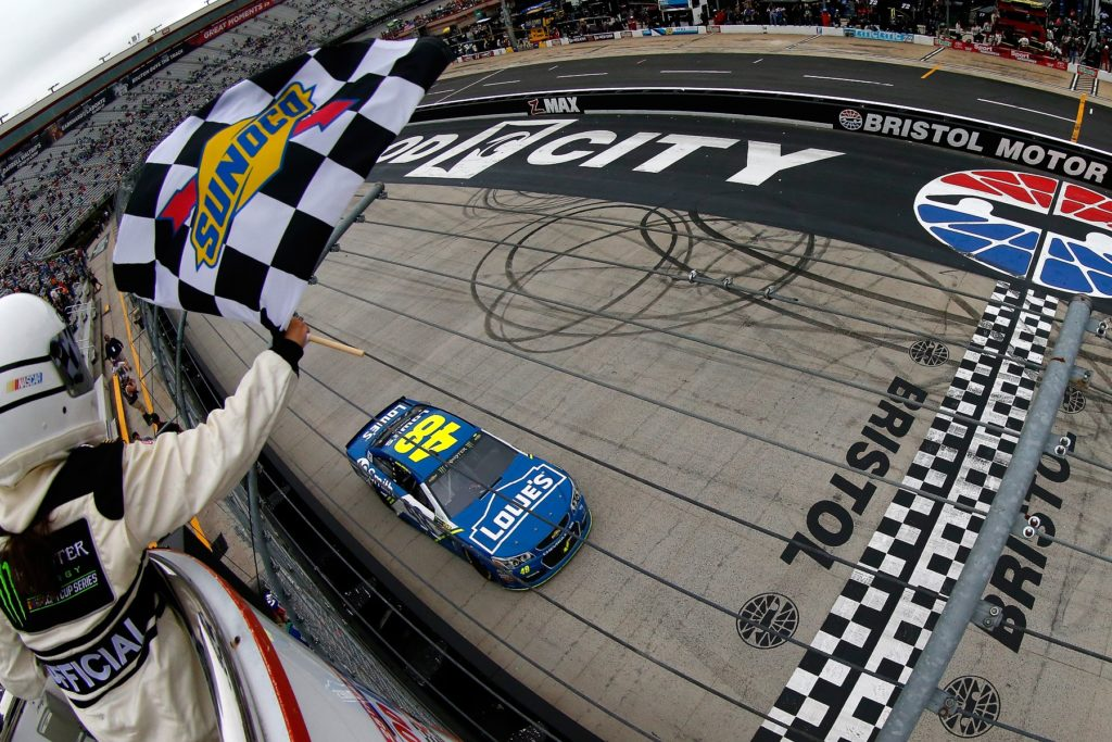 BRISTOL, TN - APRIL 24: Jimmie Johnson, driver of the #48 Lowe's Chevrolet, crosses the finish line to win the Monster Energy NASCAR Cup Series Food City 500 at Bristol Motor Speedway on April 24, 2017 in Bristol, Tennessee. (Photo by Sean Gardner/Getty Images)
