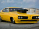 Paul H Cassidy is the proud owner of this eye-popping Dodge Super Bee. What started out life as a standard 1970 Super Bee took 15 years to transform it into what you see today. The motor was built by Koffel's Place located in Walled Lake, MI. It has been featured on the covers of such magazines as JEGS and Chrysler Power. A cool detail about the car is that it is built with Aircraft NAS bolts and jet nuts; because if your car flies you better have the proper hardware. Paul finished this beauty last Summer and has still yet to make a full pass,  which something we are eagerly awaiting! SPECS:  383 Motor built by Koffel's Place.  Shortened wheelbase 10 inches to 108/109 staggered from 118 inches stock. Shortened car 10 inches. Steel roof & quarter panels. Hand made, one of a kind, one piece front clip. Skinny Kid Chassis certified 6.00 or faster. 5 speed lenco with custom made pistol grip shifters. Pro star fuel pump. MSD coil & Wires. Powermaster Alternator. Weiland tunnel ram albeit modified .Holley 660 Center squirters Carbs. Starlite Hose.s Earls AN fittings. Mopar Performance valve covers. System one oil filter. Autometer Tachometer & Racepak data logger. Simpson belts. JEGs Roll bar padding. CO2 Bottle.