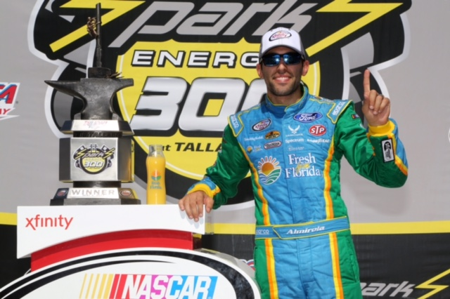 TALLADEGA, AL - MAY 06: Aric Almirola, driver of the #98 Fresh from Florida Ford, poses in Victory Lane after winning the NASCAR XFINITY Series Sparks Energy 300 at Talladega Superspeedway on May 6, 2017 in Talladega, Alabama. (Photo by Jerry Markland/Getty Images)