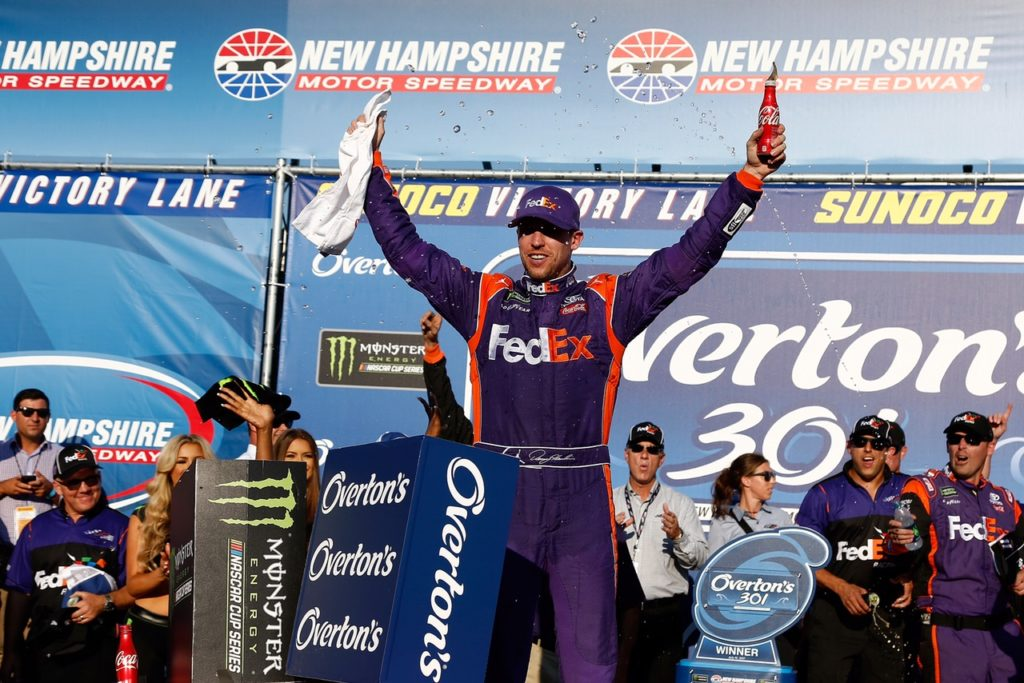 LOUDON, NH - JULY 16: Denny Hamlin, driver of the #11 FedEx Office Toyota, celebrates in Victory Lane after winning the Monster Energy NASCAR Cup Series Overton's 301 at New Hampshire Motor Speedway on July 16, 2017 in Loudon, New Hampshire. (Photo by Jeff Zelevansky/Getty Images)