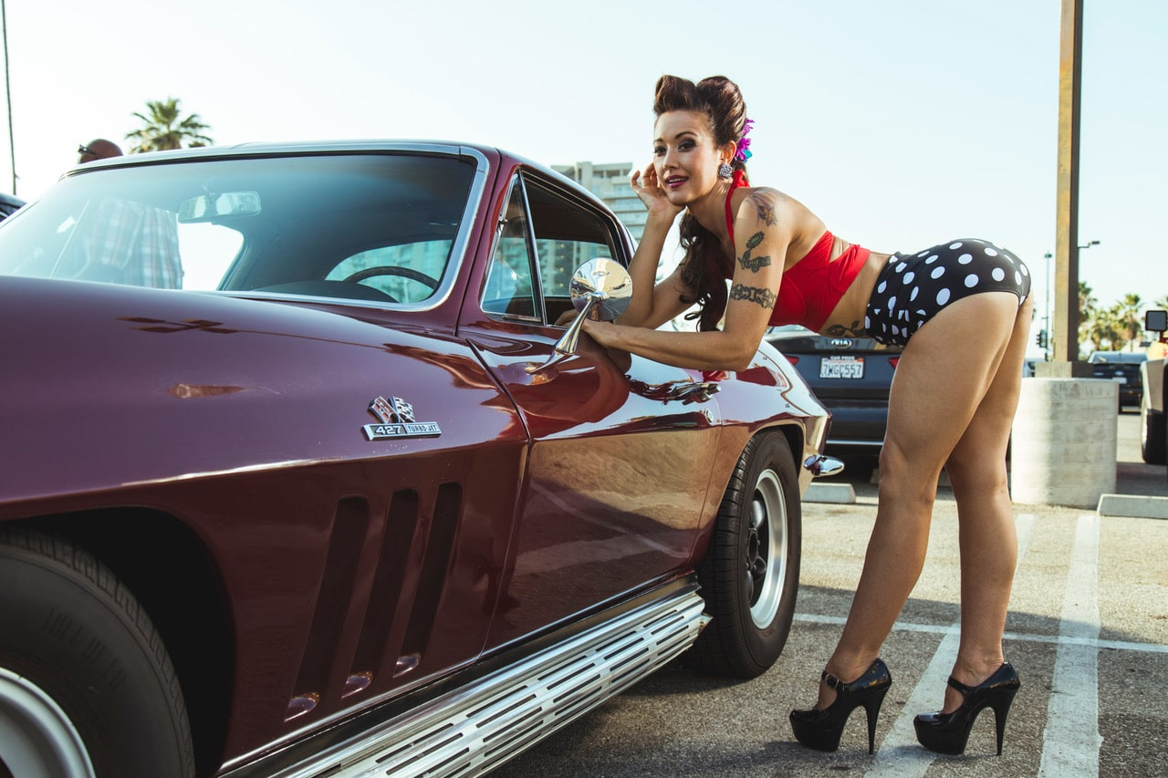 """You've seen the car, you've seen the model, but you've never seen them together! And what a combination it is! This week's Pinup Pole Show Pinup of the Week isMonica Kay. Here Monica Kay is posing with a 1966 Corvette Stingray, photographed by the always-impeccablePedro RodriguezatTonya Kay's Pinup Pole Show! Monica Kay is the girl that puts the f.u. in tofu. She loves pole dance and vegan food. She teaches yoga and pole dancing virtually these days, so you don't have to miss a single classduring quarantine.  If you missed our live, virtual show last weekend, don't fret! The""""Late Seating"""" tickets areavailable online where you can access aninstant replay of the entire performance! To see last weekend's show, grab a seat herehttps://app.gopassage.com/venues/2851"""